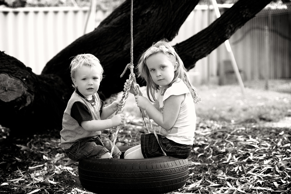 Brother and sister pose for me in this family photograph in Bassendean
