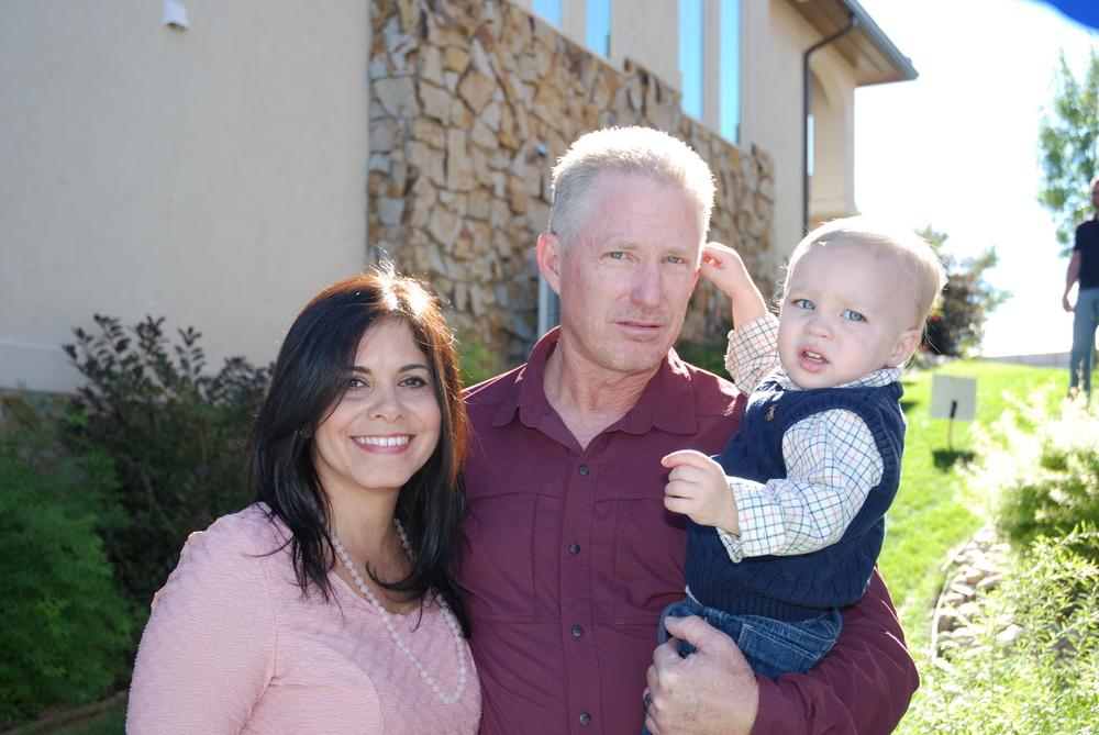 Zenaida and Doug with grandson, Kingston