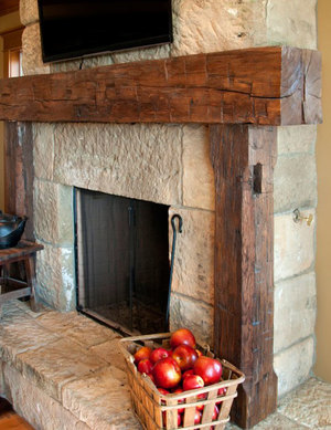 Our gorgeous hand hewn timbers make the perfect fireplace mantel and add a  centerpiece for intrigue and conversation.  Hand hewn timbers are carefully  pulled from the structure
