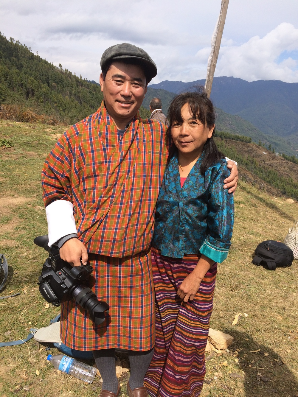 Pema, his wife and camera