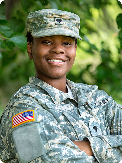Female solider in uniform smiling and the camera