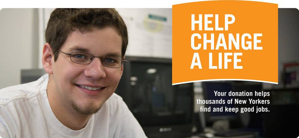 "Man wearing glasses smiling at the camera surrounded by computer monitors. Top text reads: ""Help Change A Life."" Bottom text reads: ""Your donation helps thousands of New Yorkers find and keep good jobs"""