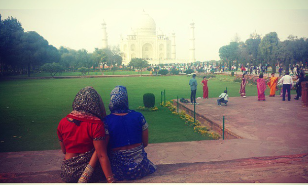 Dee and I gazing into the Taj Mahal just ahead of us, in our sarees.