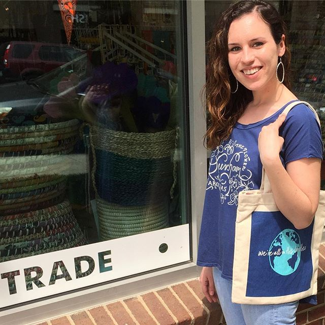 "Volunteer Sarah is ready for some shopping in the Bull City with our free spirit earrings and new organic cotton tote that proudly proclaims ""we're all in this together."" 🌏 #madeinindia #reusablebag #locallove #allinthistogether #volunteersrock"