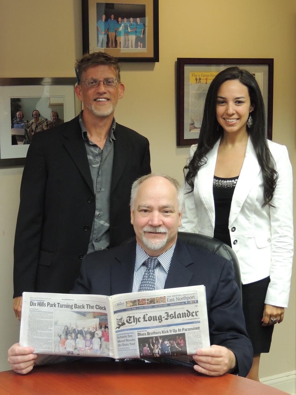 Jim Kelly (front), Peter Sloggatt (back left), and Luann Dallojacono (back right) pose for a photo.