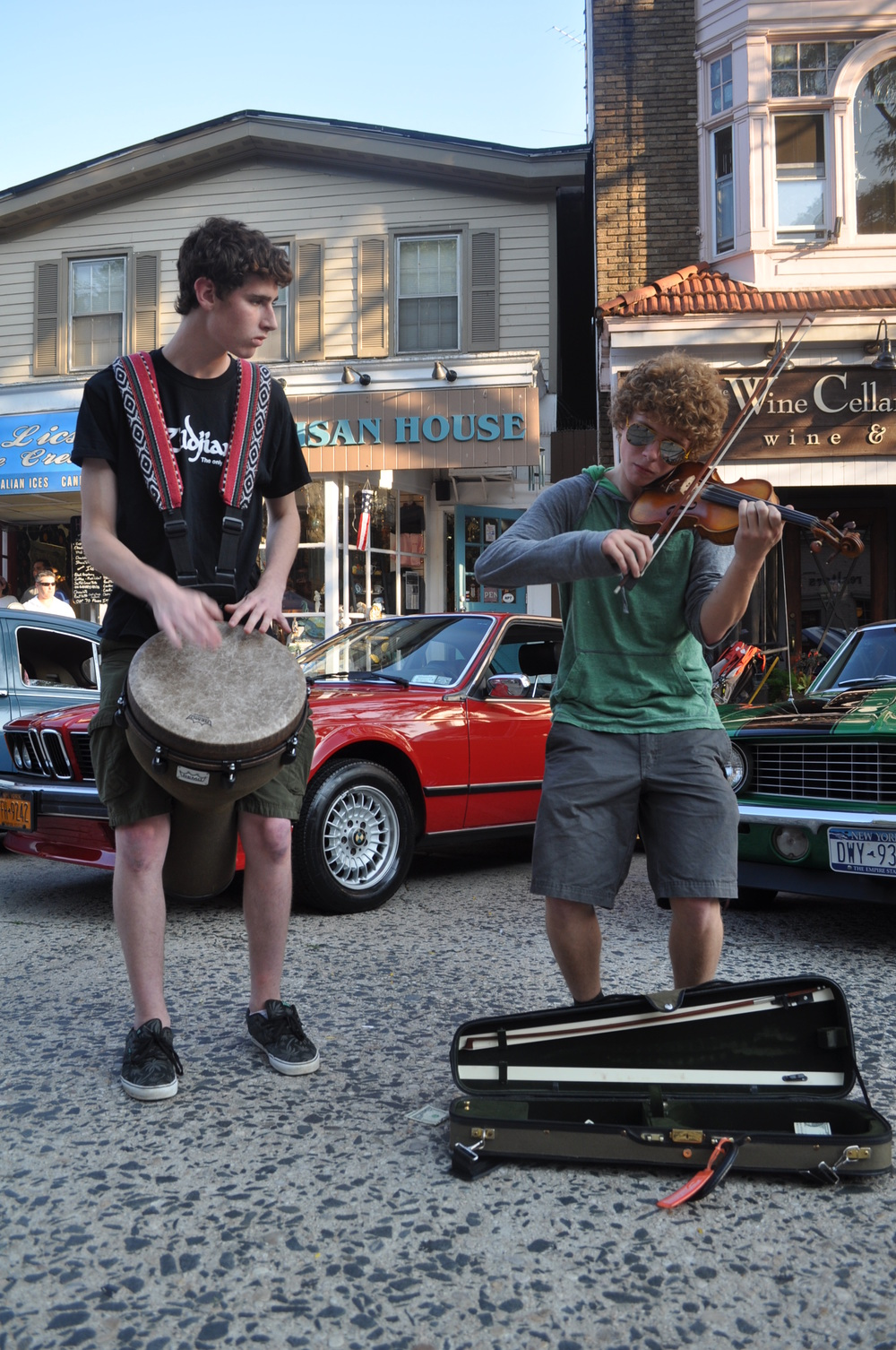 "Performers Jon Geller (percussion) and Samuel Zazu (violin), both of Centerport, take the ""stage"" on Main Street."
