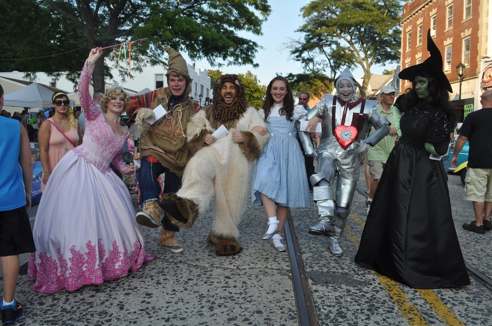 """Members of the John W. Engeman Theater's upcoming production of """"The Wizard of Oz"""" turn Northport's Main Street into their own personal Yellow Brick Road."""