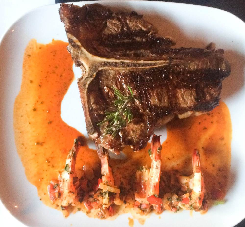 One of the night's specials, a 32-oz. Porter House steak ($42) with a a side of Shrimp Scampi.
