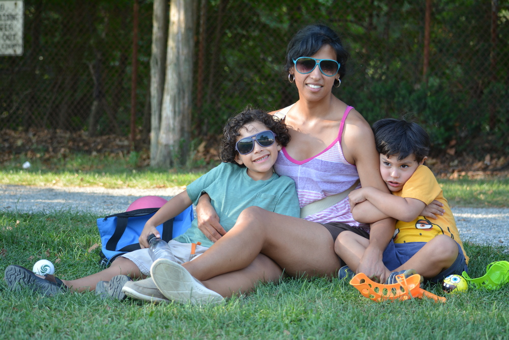 "Paola Glassmann brought her sons, six-year-old Benjamin, left, and Samuel, 4, to be extras in ""Good Friday,"" which filmed scenes in Greenlawn Park Wednesday."