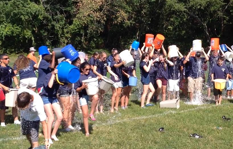 "One hundred thirty-two members of the Huntington High School Marching Band take the ""ice bucket challenge"" Sunday."