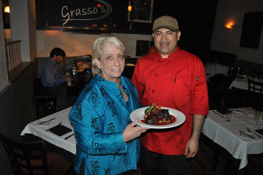 Gail Grasso, pictured with chef Tony Canales, has turned her 20th anniversary in Cold Spring Harbor into a yearlong, Sunday evening birthday bash with a throwback menu and throwback prices to boot.