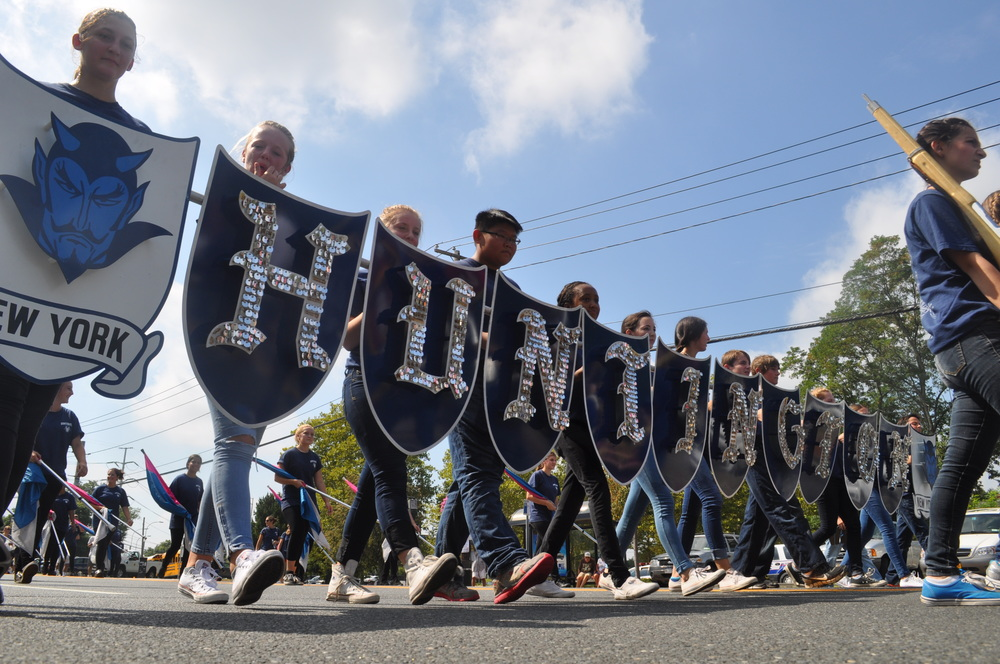 The famous shields of the Huntington High School Blue Devil Marching Band cut a majestic presence on the parade route.