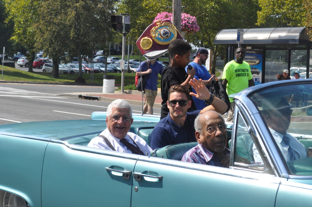 Parade Grand Marshals Anthony Mastroianni, Tom Jerideau and Chris Algieri greet attendees at the Huntington Awareness Parade from a vintage Lincoln Continental convertible.