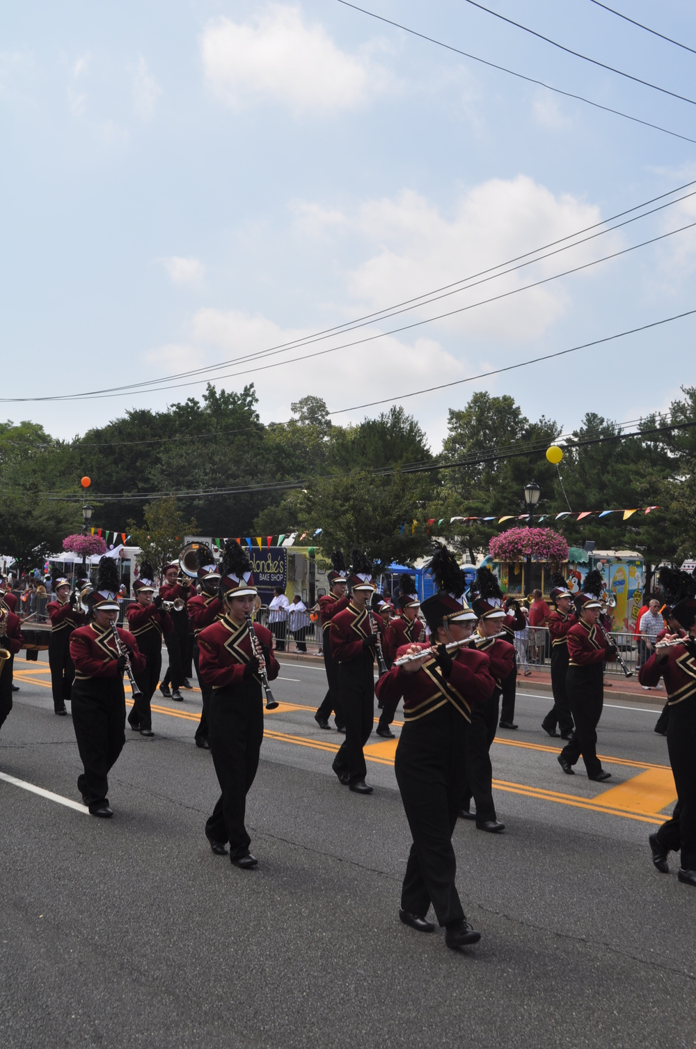 The Whitman Wildcats marching band braves the heat in full uniform to delight spectators.