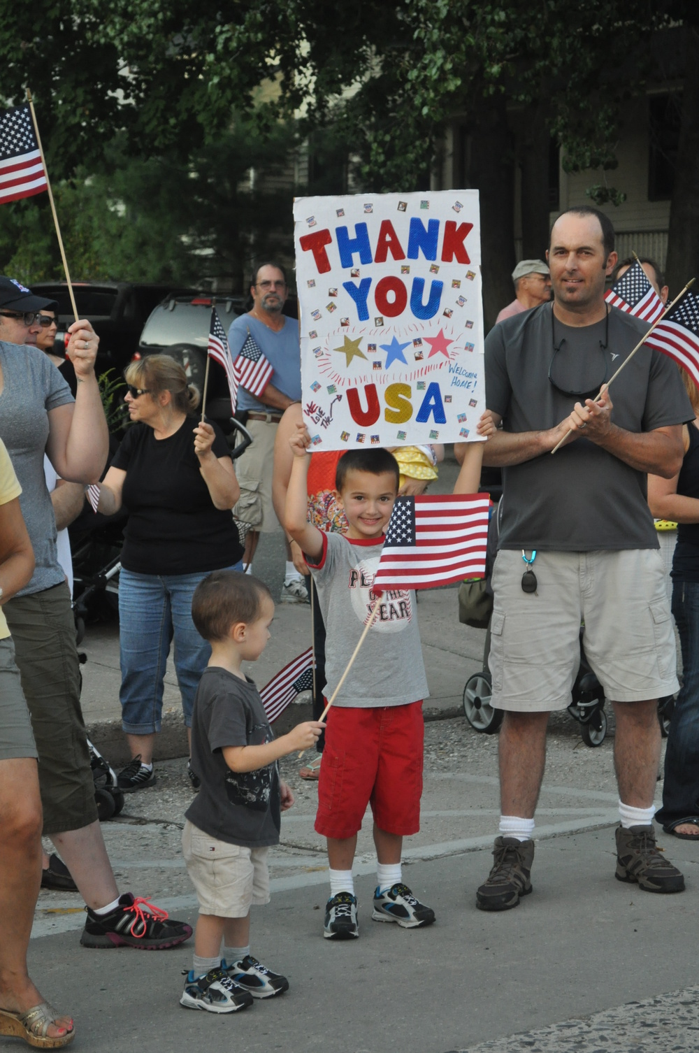 A youngster shows his appreciation during Friday evening's parade.