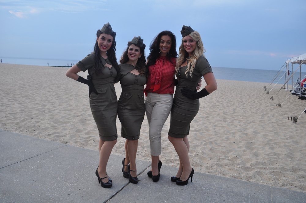 The American Bombshells, pictured with founder and manager Ali Kat, of Centerport, third from left, performed patriotic tunes at the parade and clam bake.