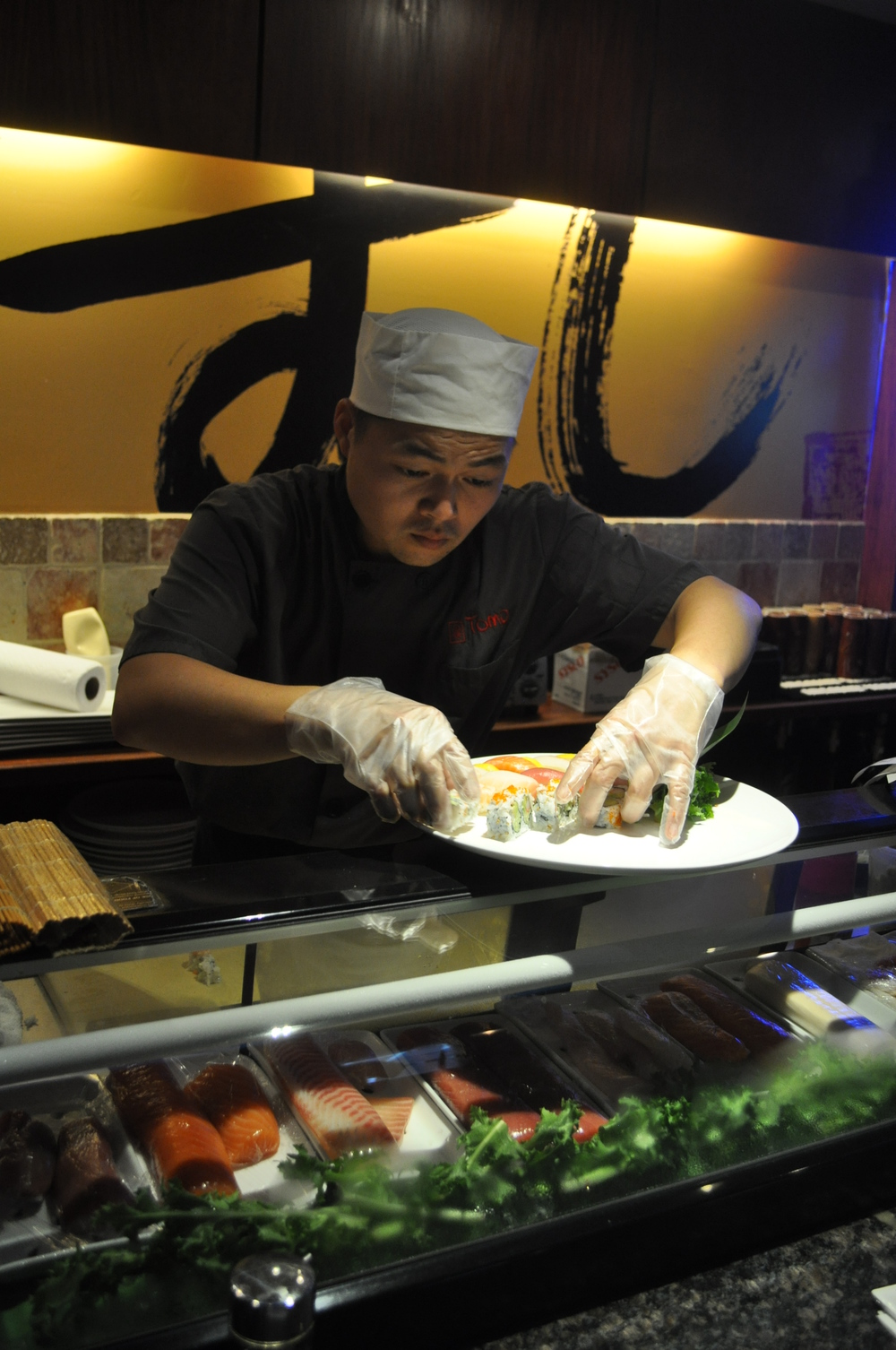 Sushi chef Kawa dazzles at the sushi bar, presenting an array of traditional favorites and inventive rolls.