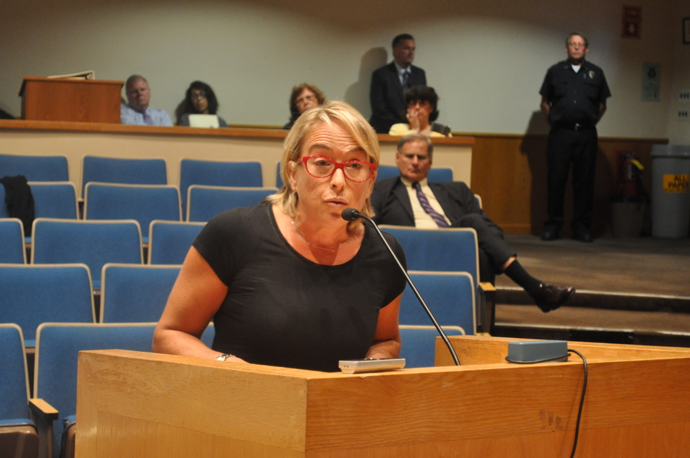 School board president Emily Rogan raised concerns at Town Hall over the impact tax abatements and development plans would have on the Huntington School District.