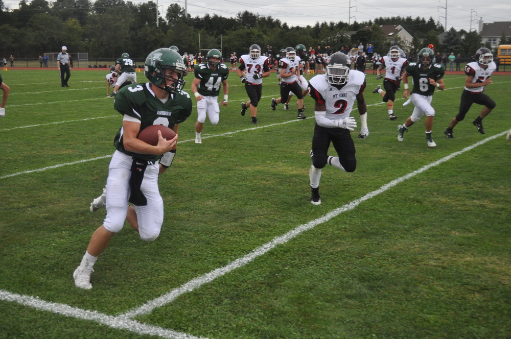 Quarterback Cody Cunningham rushes for Harborfields, setting the stage for the Tornadoes' first touchdown at homecoming Saturday.