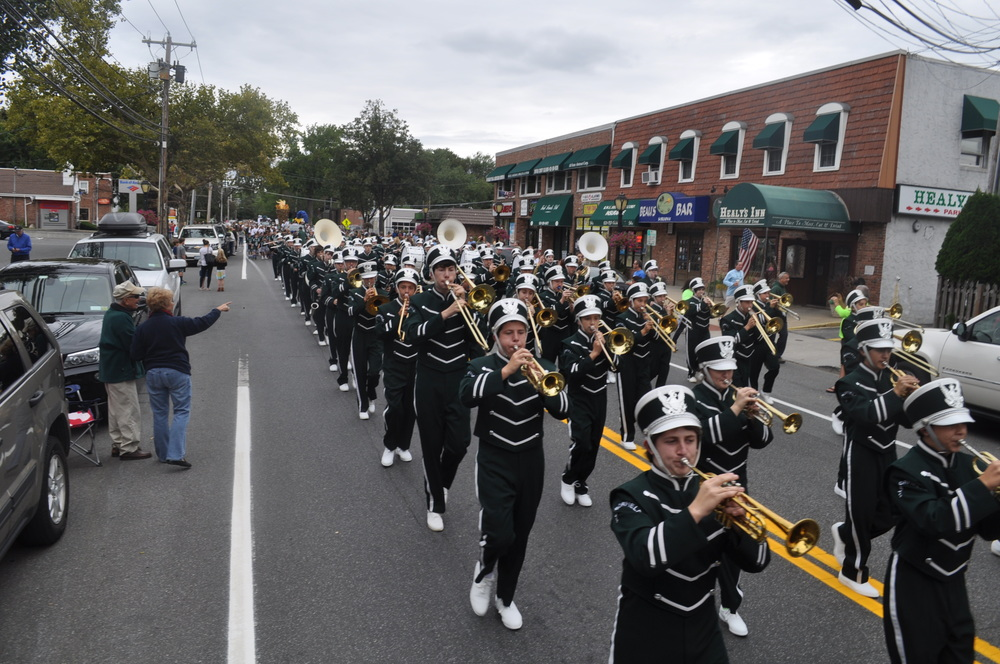 The Harborfields Marching Band makes their way down Broadway.