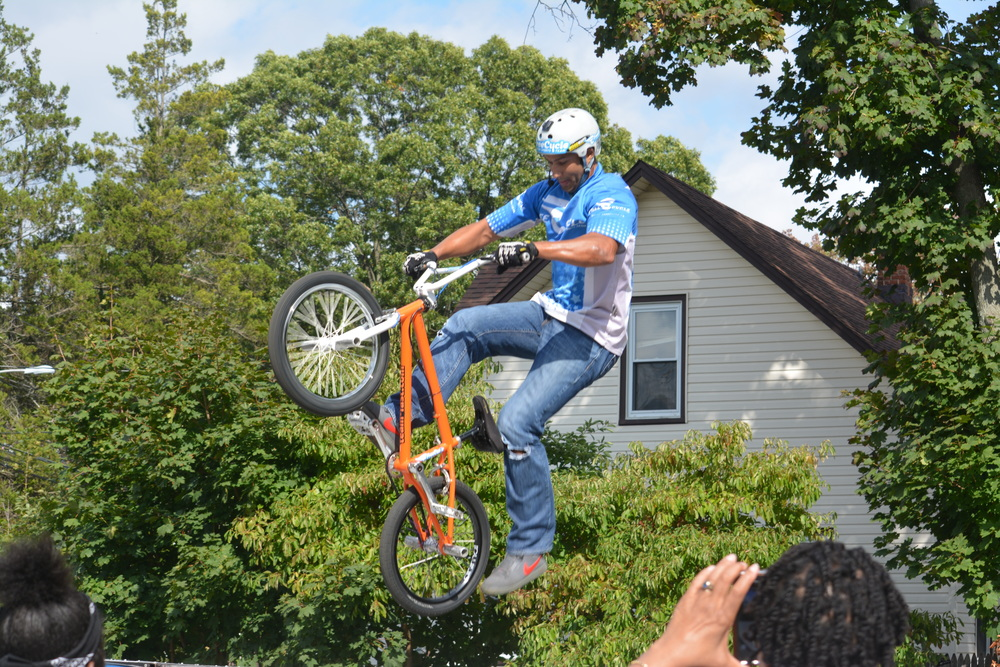 The FreeCycle Action Sports Team puts on a BMX stunt show.