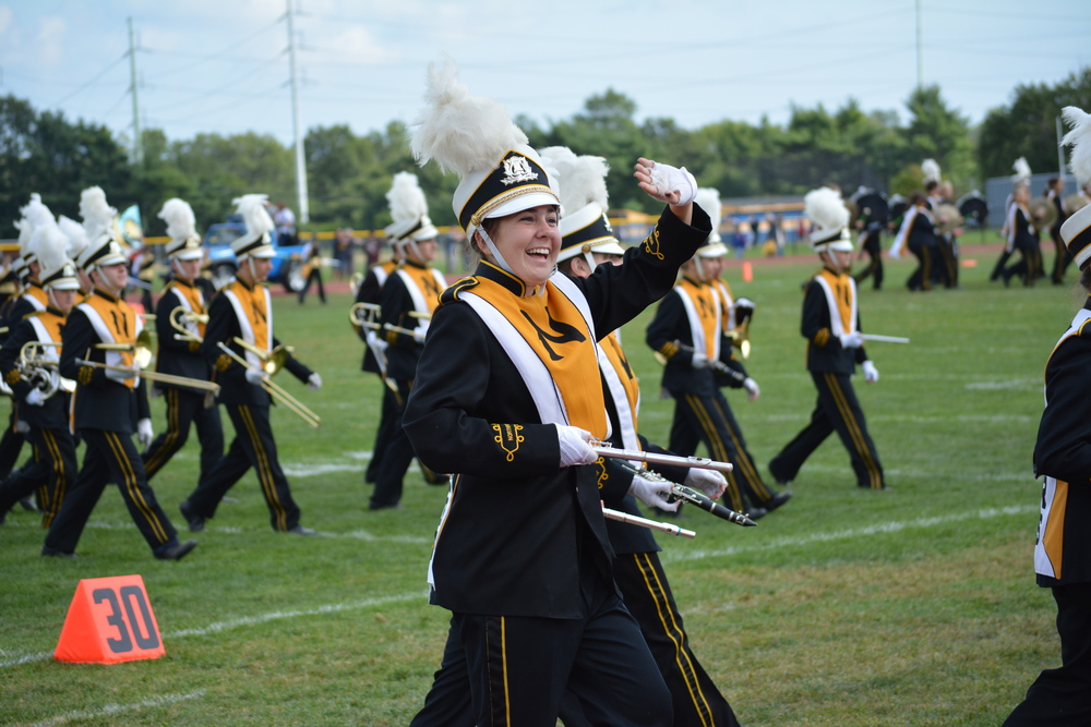 Smiles from the Northport High School band shined at halftime as the boys and girls took to the field for a performance during the break on Saturday.