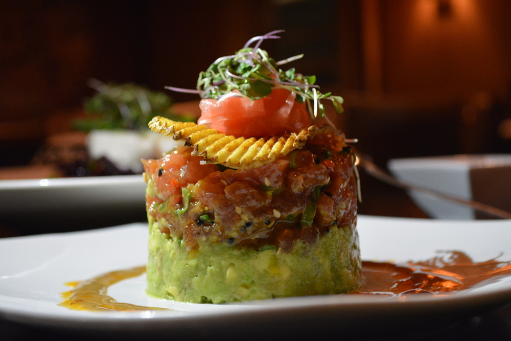 Vibrantly-colored Saku Tuna Tartare ($15) is a layered, cylindrical creation.