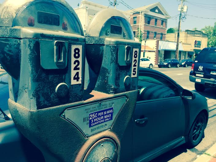 Town officials estimate a $1.6 million shortfall in parking meter revenues in 2014 after plans to upgrade coin-operated meters, pictured, were delayed.