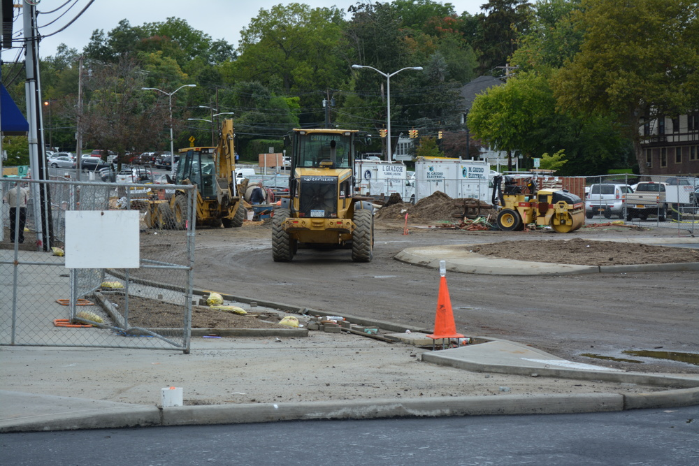 Construction vehicles lay down pavement at the Gerard Street municipal parking lot on Wednesday. (Long Islander News photo/Arielle Dollinger)