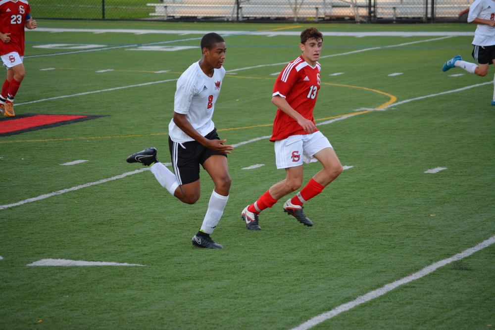 A senior defender for the Thunderbirds, David August, left, played a big part in Hills East's shutout of Smithtown East on Oct. 16.