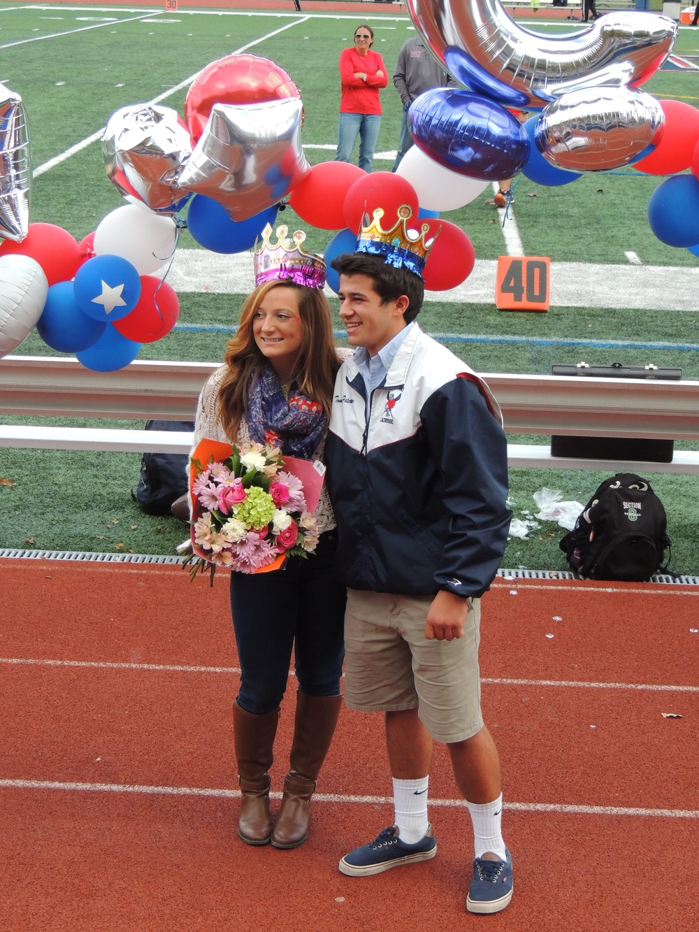 Homecoming King and Queen, Tommy Paternoster and Alicia Roy smile for pictures during Saturday's festivities at Cold Spring Harbor High School.
