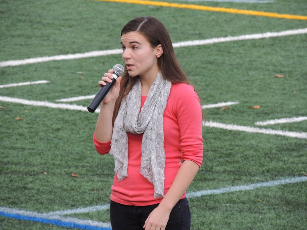 Cold Spring Harbor's Emily Gallagher sings the National Anthem during Cold Spring Harbor High School's homecoming on Saturday.