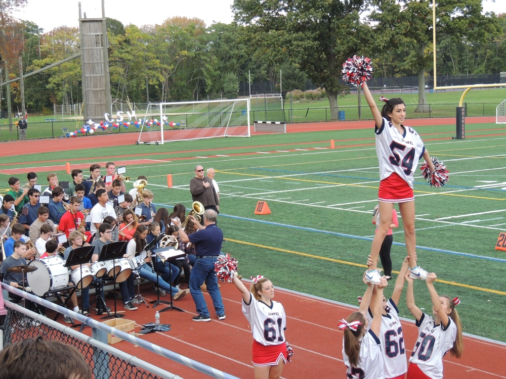 Cold Spring Harbor's cheerleaders and band perform for the crowd during Saturday's homecoming game.