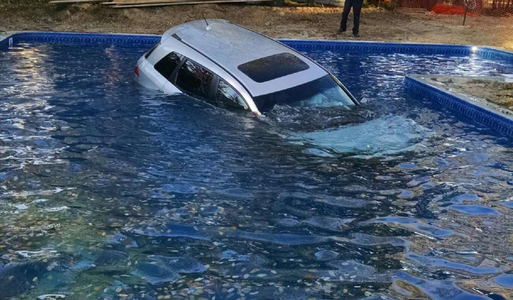 Commack resident John Bacchi rescued a Pennsylvania man whose car plunged into Bacchi's backyard pool on Monday.