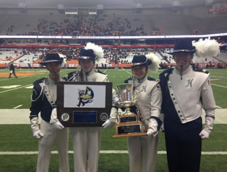 The Blue Devil band's leaders with the Governor's Cup and first-place plaque.