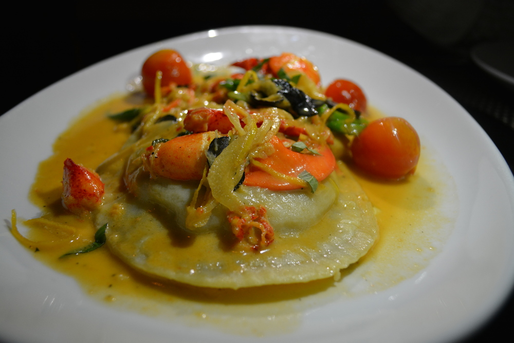 When one takes fork or knife to a piece of the Lobster Raviolo, slicing into its center, the egg yolk pours itself onto the plate.