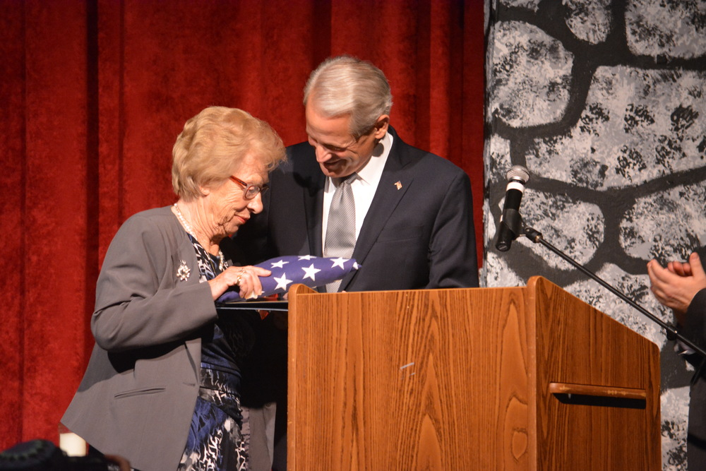 Congressman Steve Israel presents Holocaust survivor Eva Schloss with an American flag in Commack last week. (Long Islander News photo/Arielle Dollinger)