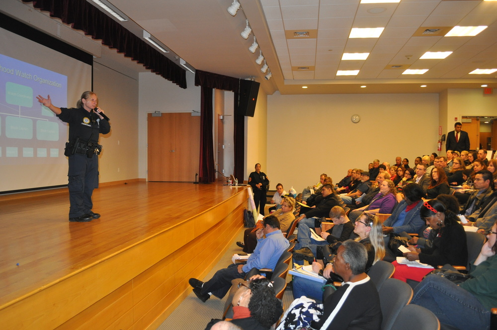Officer Angela Ferrara, who will spearhead neighborhood watch efforts in Huntington, speaks to a packed house at the South Huntington Public Library Nov. 5. (Long Islander News photo/Danny Schrafel)