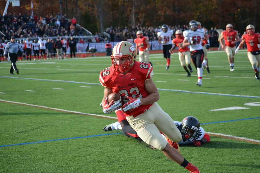 Sophomore Alexander Filacouris secures a catch for Hills West on Saturday in its playoff win against Hills East.