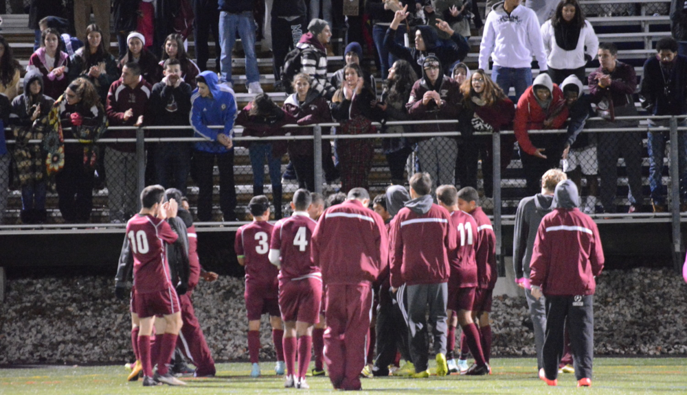 At Dowling College on Friday, the Walt Whitman boys soccer team walks over to its supports to thank them for coming out to the Suffolk County championship game.