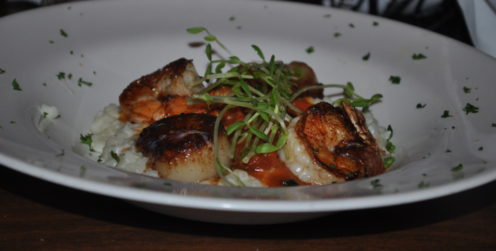 Sweet scallops and grilled shrimp meld perfectly with delicate risotto, dressed in a tomato-saffron broth.