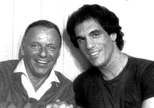 Robert Davi posing for a picture with Frank Sinatra, back in 1977.