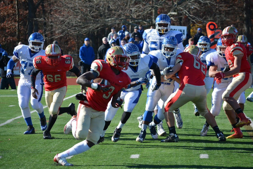 Raymond Lyte (No. 3) breaks off a run for Hills West during Saturday's county semifinal game against Riverhead. Lyte filled in to take a majority of the carries in the game as Lucas DiGiorgi was inactive with a foot injury.