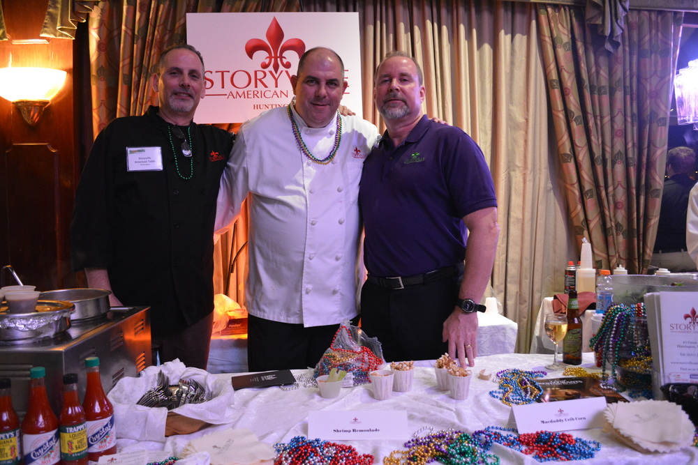 Storyville American Table owner and Executive Chef Brian Finn, center, along with the restaurant's Mike Wallace, left, and Thomas Curry, handed out Mardi Gras beads.
