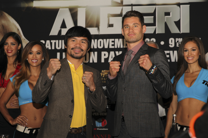 Greenlawn's Chris Algieri, right, poses with his soon-to-be opponent, Manny Pacquiao – the man Algieri will face in the ring on Saturday. (Photo by Star Boxing).