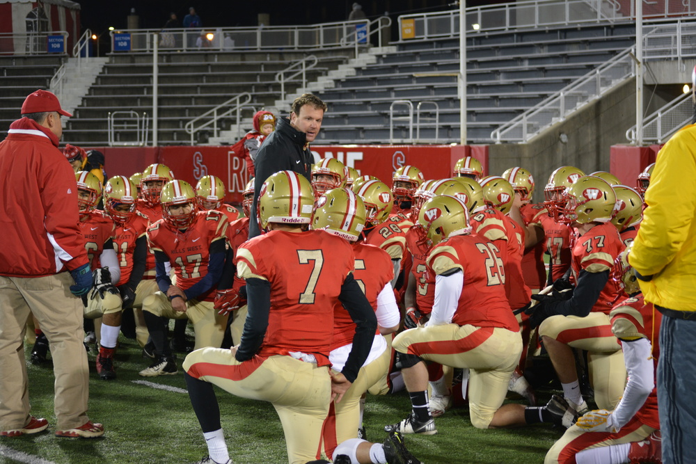 Colts Head Coach Kyle Madden addresses his team on the football field one final time this season on Saturday at Stony Brook University.