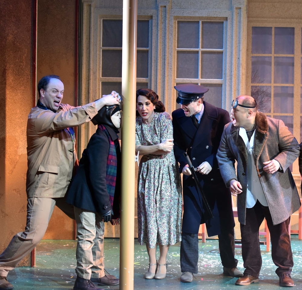 "Chad Jennings, Vincent Gerardi, Kathryn Markey, Larry A. Lozier, Jr. and Viet Vo in a famous scene from ""A Christmas Story."" (Photo: Engeman Theater)."