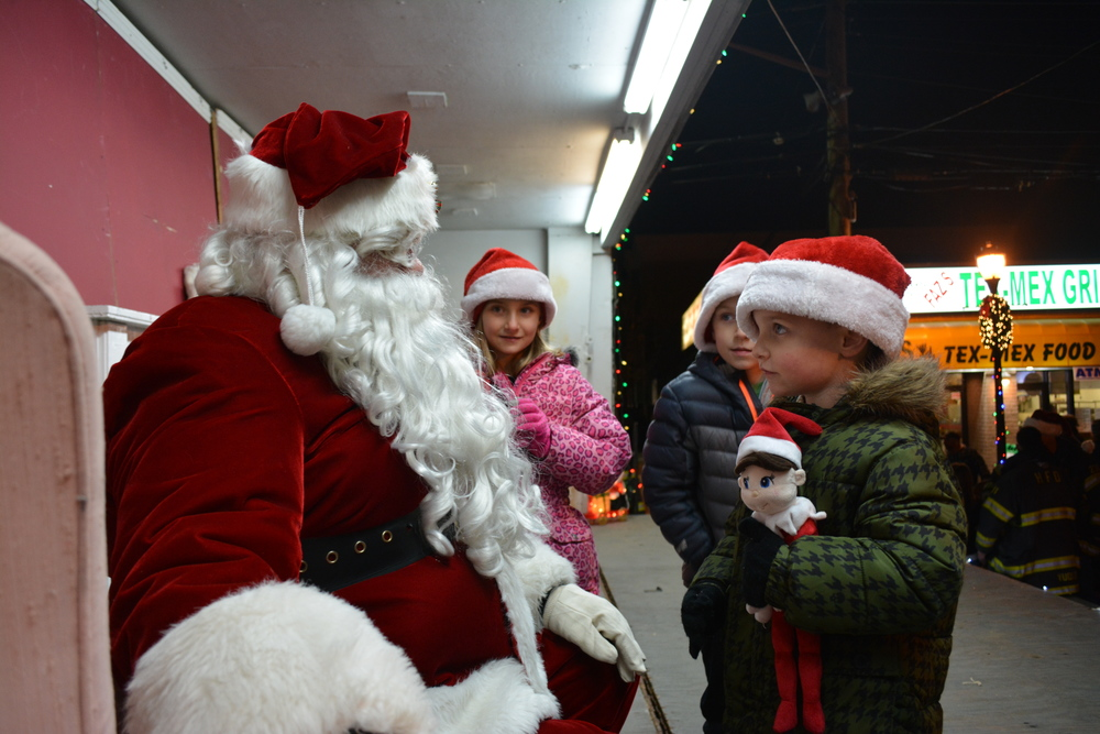 Centerport siblings Keira Riegler, 8, Nathan Riegler, 6, and Jack Riegler, 5, visited Santa after the parade.