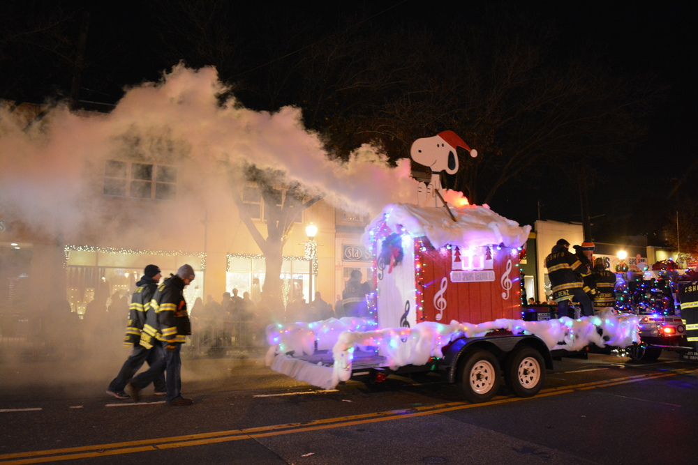 The Cold Spring Harbor Fire Department blew smoke as it brought is Snoopy float down Main Street.