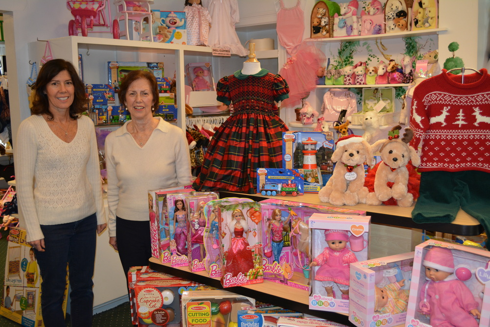 Owner of Cold Spring Harbor's Pashley Children's Boutique Pat Ramsay, right, poses with her daughter Debbie Schipper, one of Ramsay's employees at the 169 Main St. location.